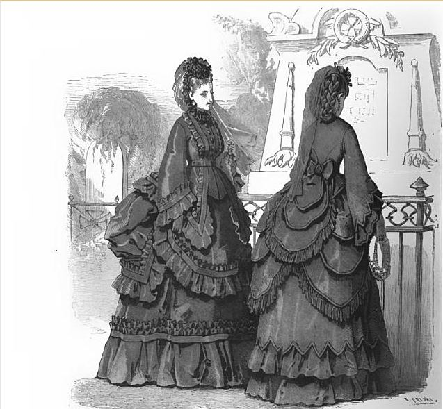 Ladies dressed in black attire - even covering heads and hands